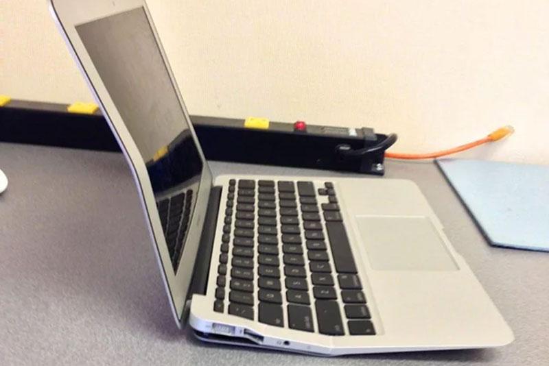 Macbook Air ran over by a busy mum